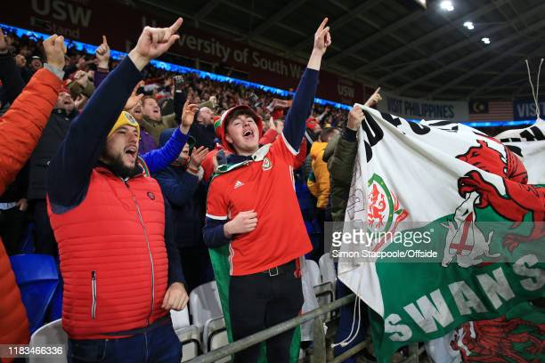 Wales fans celebrate victory and qualification after the UEFA Euro 2020 Qualifier between Wales and Hungary at Cardiff City Stadium on November 19...