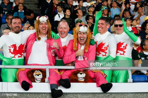 TOPSHOT Wales' fans cheer before the start of the Japan 2019 Rugby World Cup semifinal match between Wales and South Africa at the International...