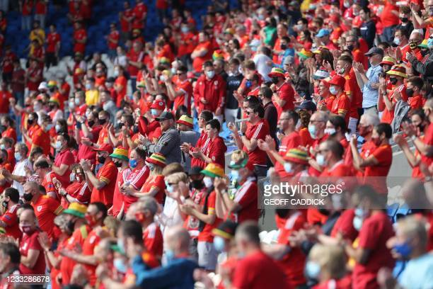 Wales fans cheer in the crowd during the international friendly football match between Wales and Albania at Cardiff City Stadium in Cardiff, South...