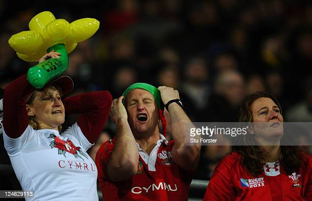 Wales fans react to their team's 16-17 defeat during the IRB 2011 Rugby World Cup Pool D match between South Africa and Wales on September 11, 2011...