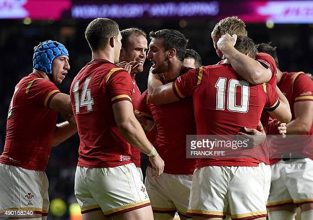 Wales' flanker and captain Sam Warburton celebrates with teammates after winning a Pool A match of the 2015 Rugby World Cup between England and Wales...