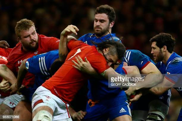 Wales' flanker Josh Navidi battles with France's number 8 Marco Tauleigne in a maul during the Six Nations international rugby union match between...
