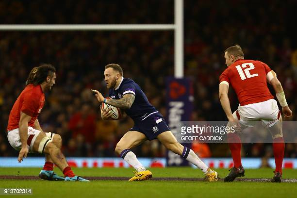 Wales' flanker Josh Navidi confronts Scotland's wing Byron McGuigan during the Six Nations international rugby union match between Wales and Scotland...