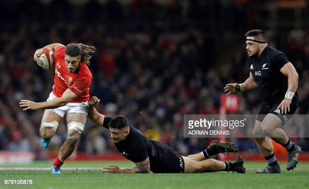 Wales' flanker Josh Navidi is tackled by New Zealand's hooker Codie Taylor during the Autumn international rugby union Test match between Wales and...