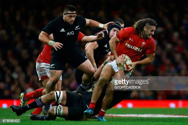 Wales' flanker Josh Navidi is tackled during the Autumn international rugby union Test match between Wales and New Zealand at the Principality...