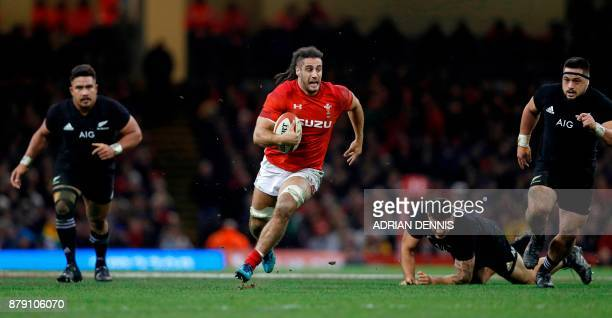 Wales' flanker Josh Navidi runs with the ball during the Autumn international rugby union Test match between Wales and New Zealand at the...