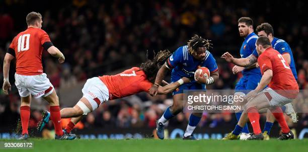 Wales' flanker Josh Navidi tackles France's center Mathieu Bastareaud during the Six Nations international rugby union match between Wales and France...