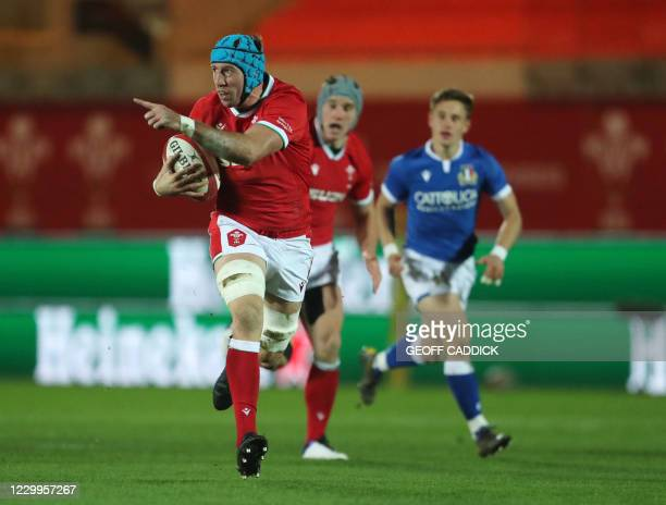 Wales' flanker Justin Tipuric breaks through Italy's defence to set up the opening try during the Autumn Nations Cup international rugby union match...