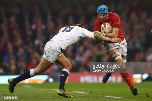TOPSHOT Wales' flanker Justin Tipuric is tackled by England's centre Henry Slade during the Six Nations international rugby union match between Wales...