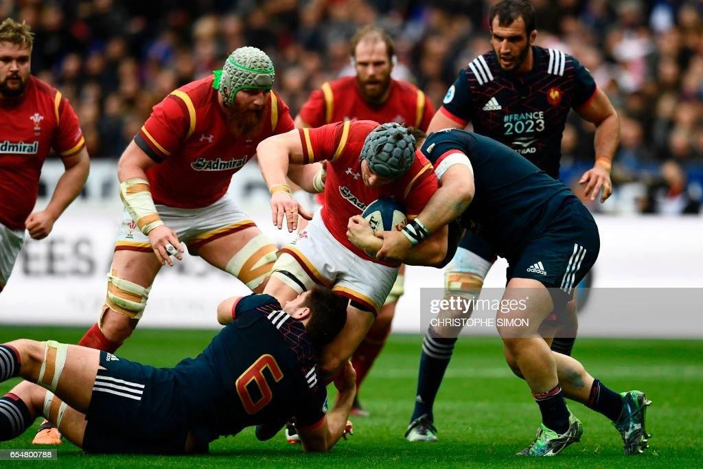 TOPSHOT - Wales' flanker Justin Tipuric (C) is tackled by France's flanker Fabien Sanconnie during the Six Nations tournament Rugby Union match between France and Wales at the Stade de France in Saint-Denis, outside Paris, on March 18, 2017. /