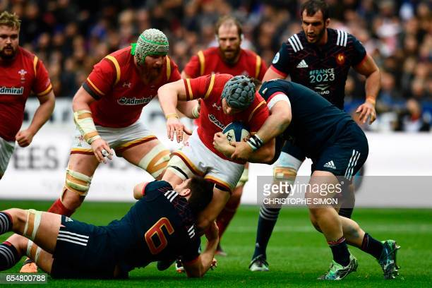 TOPSHOT Wales' flanker Justin Tipuric is tackled by France's flanker Fabien Sanconnie during the Six Nations tournament Rugby Union match between...