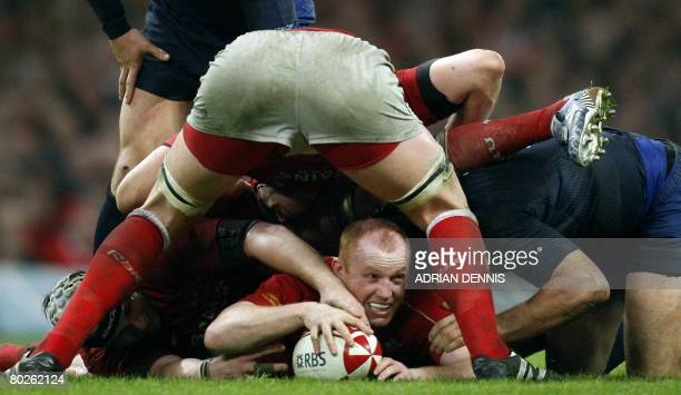 Wales' flanker Martyn Williams gets the ball out from a ruck as France's Captain Lionel Nallet waits during the Six Nations tournament at the...