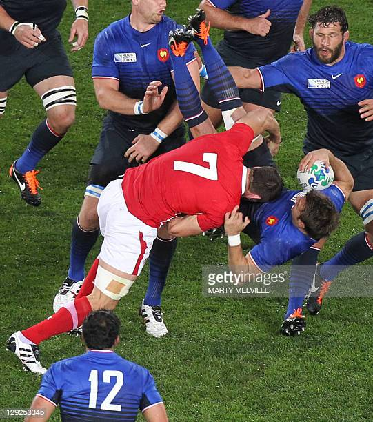 Wales' flanker Sam Warburton tackles dangerously France's right wing Vincent Clerc and gets red carded during the 2011 Rugby World Cup semifianl...