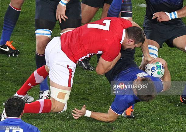 Wales' flanker Sam Warburton tackles dangerously France's right wing Vincent Clerc and gets red carded during the 2011 Rugby World Cup semi-fianl...