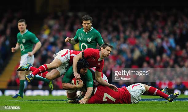 Wales flyhalf Dan Biggar and Sam Warburton put in a tackle on Ireland player Sean O' Brien during the RBS Six Nations game between Wales and Ireland...