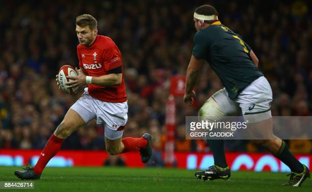 Wales' flyhalf Dan Biggar avoids South Africa's prop Wilco Louw during the international rugby union test match between Wales and South Africa at the...