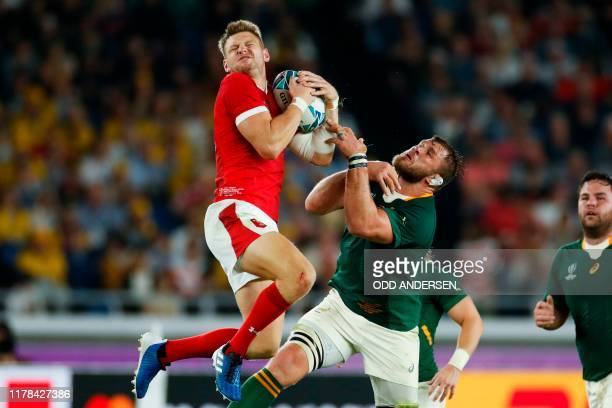 Wales' fly-half Dan Biggar catches the ball during the Japan 2019 Rugby World Cup semi-final match between Wales and South Africa at the...