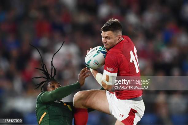 Wales' flyhalf Dan Biggar catches the ball past South Africa's wing S'Busiso Nkosi during the Japan 2019 Rugby World Cup semifinal match between...