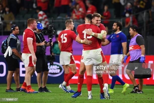 Wales' flyhalf Dan Biggar hugs Wales' centre Owen Watkin after winning the Japan 2019 Rugby World Cup quarterfinal match between Wales and France at...
