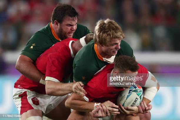 Wales' flyhalf Dan Biggar is tackled by South Africa's flanker PieterSteph Du Toit during the Japan 2019 Rugby World Cup semifinal match between...