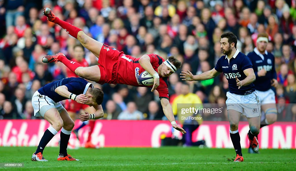 Wales flyhalf Dan Biggar is taken out by Finn Russell of Scotland and subsequently shown a yellow card during the RBS Six Nations match between Scotland and Wales at Murrayfield Stadium on February 15, 2015 in Edinburgh, Scotland.