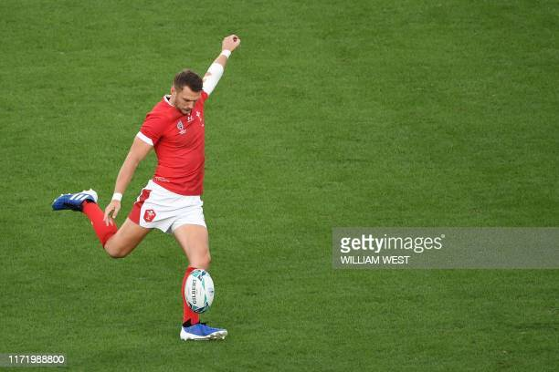 Wales' flyhalf Dan Biggar kicks a drop goal during the Japan 2019 Rugby World Cup Pool D match between Australia and Wales at the Tokyo Stadium in...