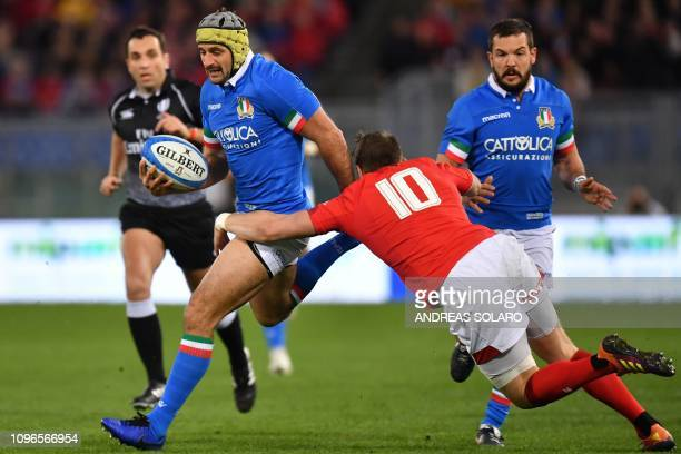 Wales' flyhalf Dan Biggar tackles Italy's winger Angelo Esposito during the Six Nations rugby union tournament match between Italy and Wales at the...