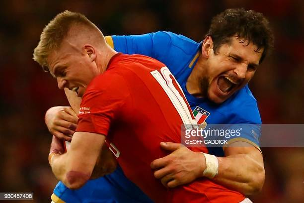 Wales' fly-half Gareth Anscombe is tackled by Italy's lock Alessandro Zanni during the Six Nations international rugby union match between Wales and...