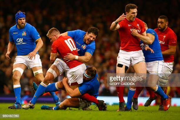 TOPSHOT Wales' flyhalf Gareth Anscombe is tackled by Italy's lock Alessandro Zanni during the Six Nations international rugby union match between...