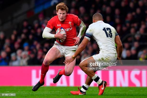 Wales' flyhalf Rhys Patchell takes on England's centre Jonathan Joseph during the Six Nations international rugby union match between England and...