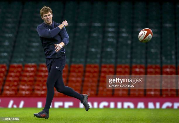 Wales' flyhalf Rhys Patchell throws a ball during a training session at the Principality Stadium in Cardiff south Wales on February 2 ahead of their...
