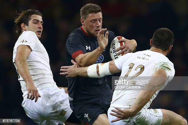 Wales' flyhalf Rhys Priestland is tackled by Georgia's centre Merab Sharikadze during the international rugby union test match between Wales and...