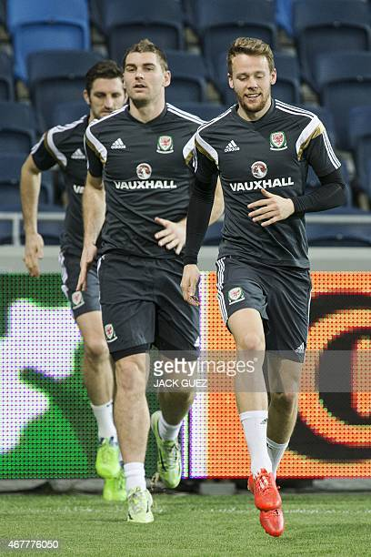 Wales' football players take part in a training session at the Sammy Ofer Stadium in the Israeli coastal city of Haifa, on March 27 on the eve of the...