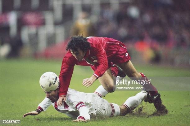 Wales footballer Ryan Giggs falls over Turkish defender Recep Cetin during play in the Wales v Turkey FIFA World Cup Group 7 qualifying match at...