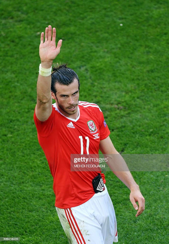 Wales' forward Gareth Bale acknowledges the crowds following their 2-1 win in the Euro 2016 group B football match between Wales and Slovakia at the Stade de Bordeaux in Bordeaux on June 11, 2016. / AFP / MEHDI