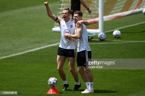 Wales forward Gareth Bale and defender Ben Davies gesture during a training session on June 8, 2021 at Tofiq Behramov stadium in Baku, four days...