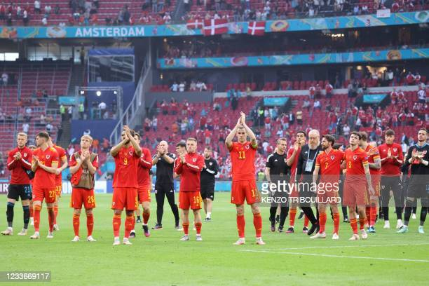 Wales' forward Gareth Bale and team-mates applaud their fans at the end of the UEFA EURO 2020 round of 16 football match between Wales and Denmark at...