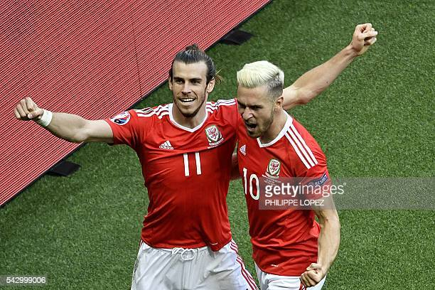 Wales' forward Gareth Bale and Wales' midfielder Aaron Ramsey celebrate after an own goal by Northern Ireland's defender Gareth McAuley during the...