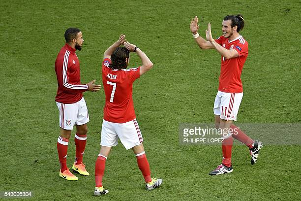 Wales' forward Gareth Bale and Wales' midfielder Joe Allen and Wales' defender Ashley Richards celebrates the team's 10 win in the Euro 2016 round of...