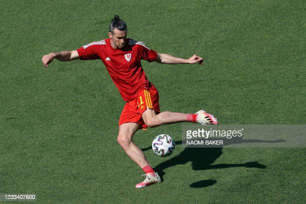 Wales' forward Gareth Bale attemps a volley during warm ups ahead of the UEFA EURO 2020 Group A football match between Wales and Switzerland at the...