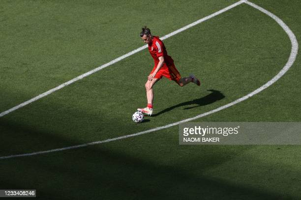 Wales' forward Gareth Bale attempts a shot during warm ups ahead of the UEFA EURO 2020 Group A football match between Wales and Switzerland at the...