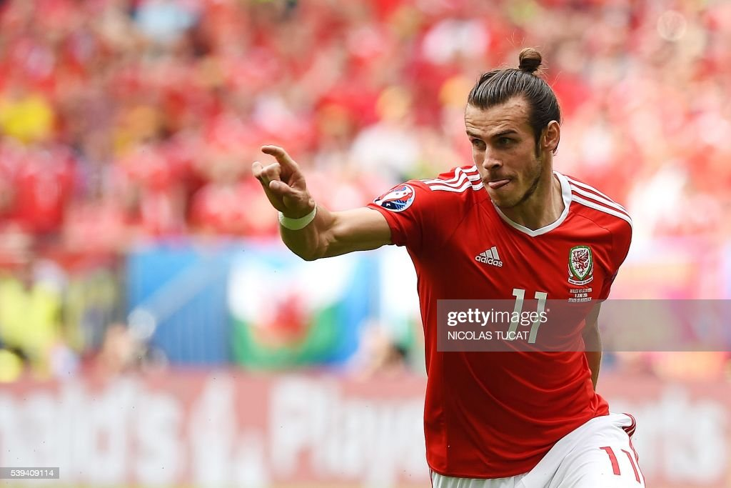 TOPSHOT - Wales' forward Gareth Bale celebrates after scoring the first goal during the Euro 2016 group B football match between Wales and Slovakia at the Stade de Bordeaux in Bordeaux on June 11, 2016. /