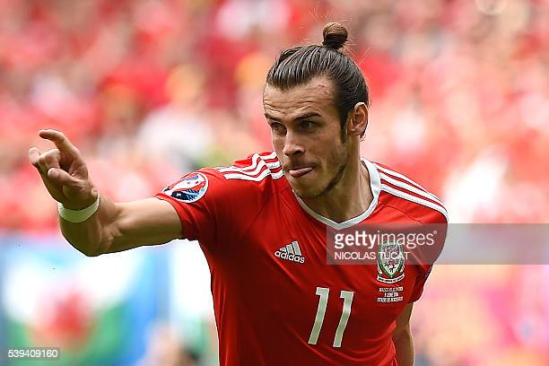 Wales' forward Gareth Bale celebrates after scoring the first goal during the Euro 2016 group B football match between Wales and Slovakia at the...