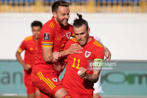 Wales' forward Gareth Bale celebrates after scoring the opening goal from the penalty spot during the FIFA World Cup Qatar 2022 qualification...