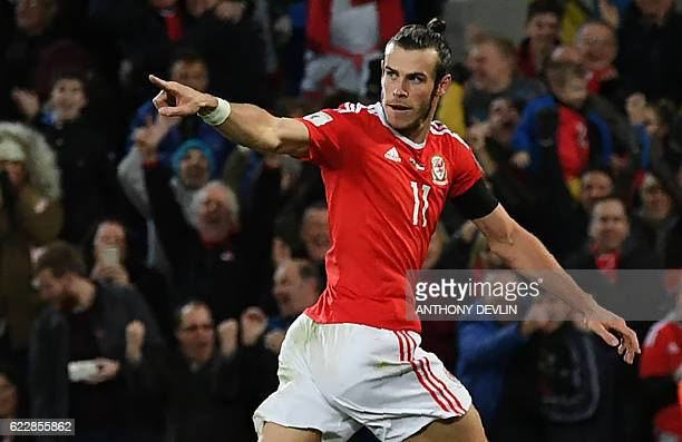 Wales' forward Gareth Bale celebrates after scoring the opening goal of the World Cup 2018 qualification match between Wales and Serbia at Cardiff...