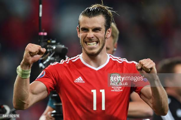 Wales' forward Gareth Bale celebrates after the Euro 2016 quarterfinal football match between Wales and Belgium at the PierreMauroy stadium in...