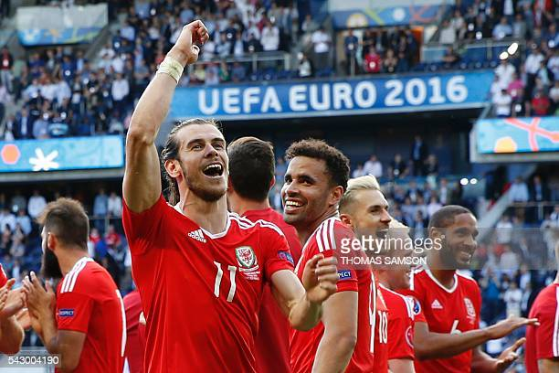 Wales' forward Gareth Bale celebrates their victory during the Euro 2016 round of sixteen football match Wales vs Northern Ireland, on June 25, 2016...