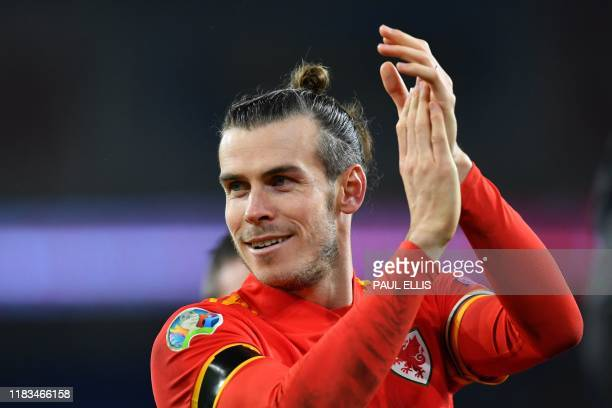 Wales' forward Gareth Bale celebrates victory and qualification after the Group E Euro 2020 football qualification match between Wales and HUngary at...