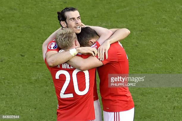 Wales' forward Gareth Bale celebrates with team mates following a 1-0 victory following the Euro 2016 round of sixteen football match Wales vs...
