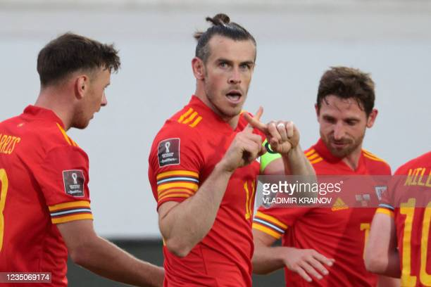 Wales' forward Gareth Bale celebrates with teammates after scoring the team's third goal during the FIFA World Cup Qatar 2022 qualification football...